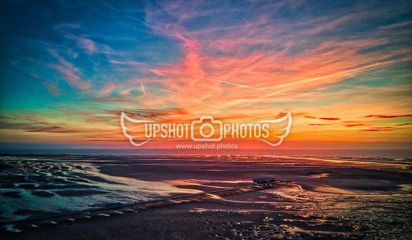 Aerial drone photography at Southport beach at sunset by Upshot Photos